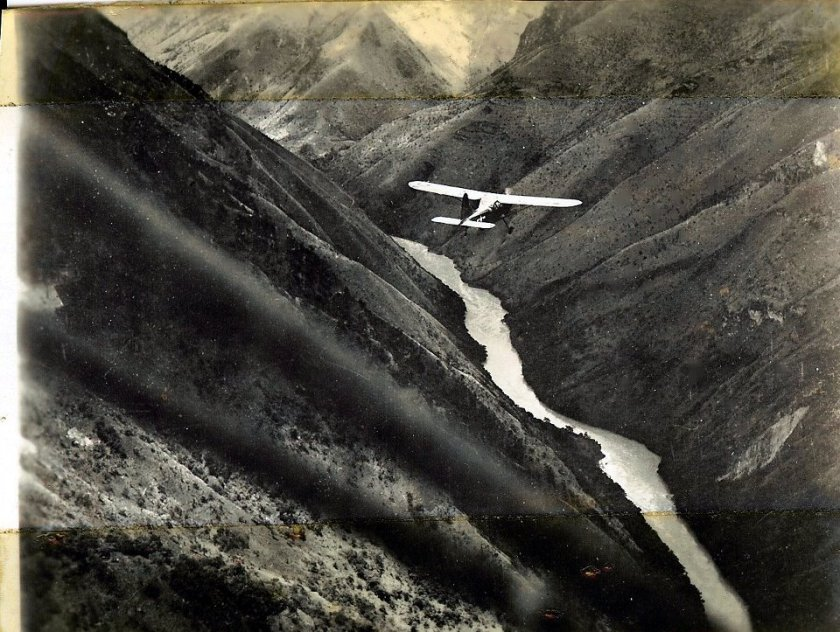 graphic of monoplane flying a mountain pass